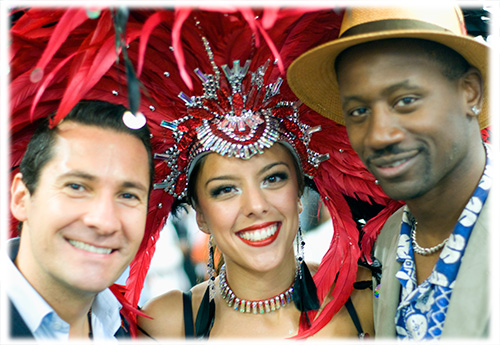 Bacardi's David Cordoba and RumFest organiser Ian burrell with Samba Dancer at RumFest
